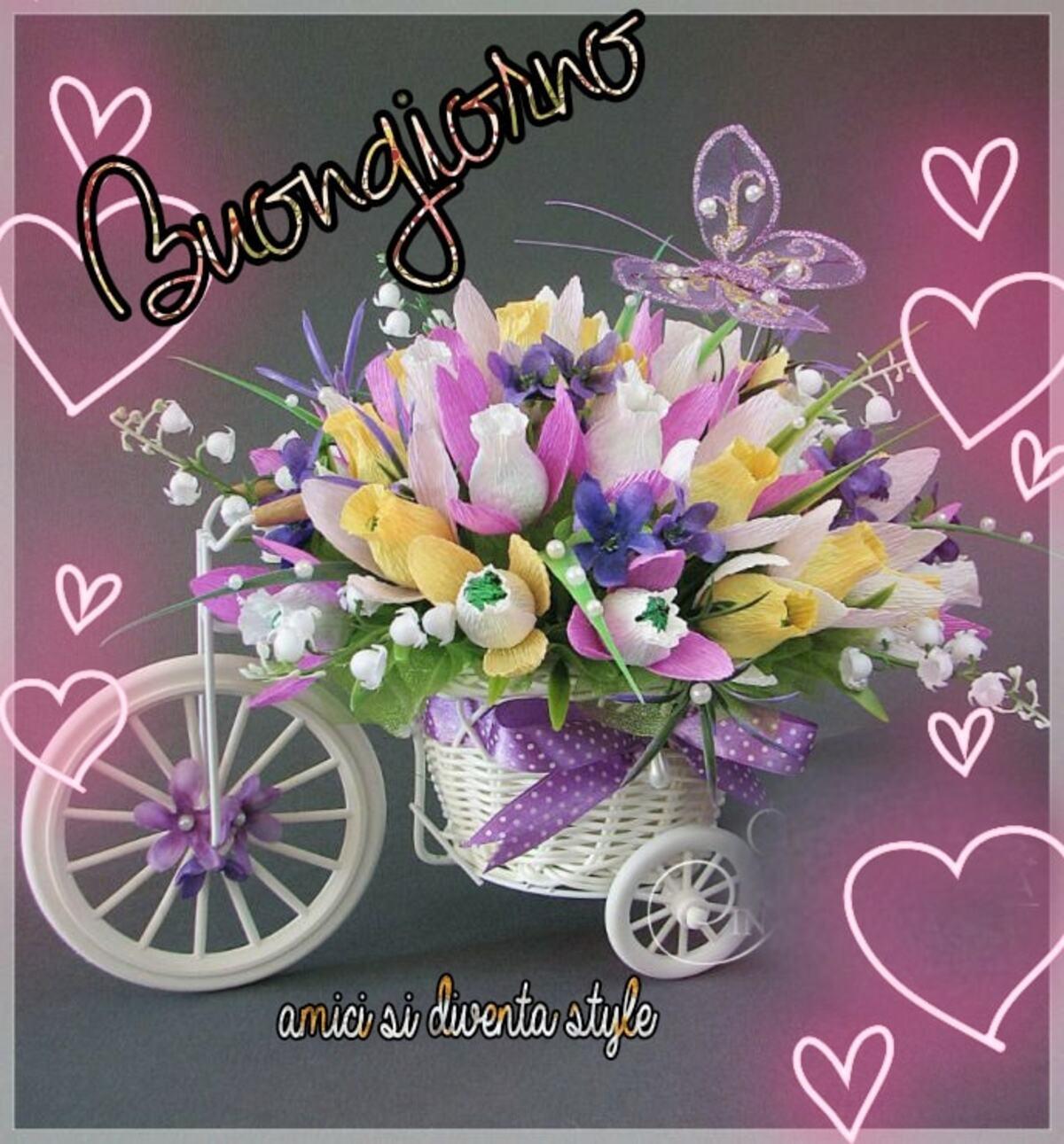 Buongiorno carriola con i fiori